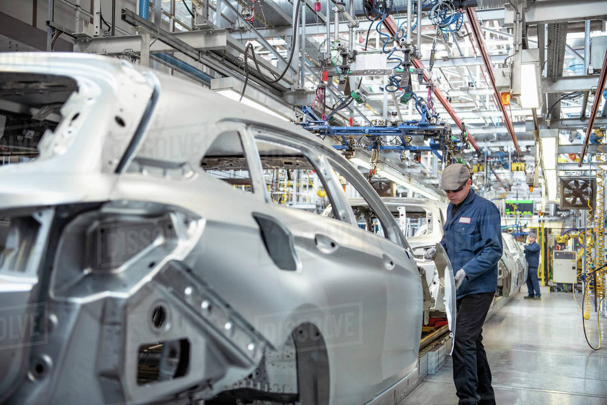 Workers on car production line in car factory Royalty-free stock photo