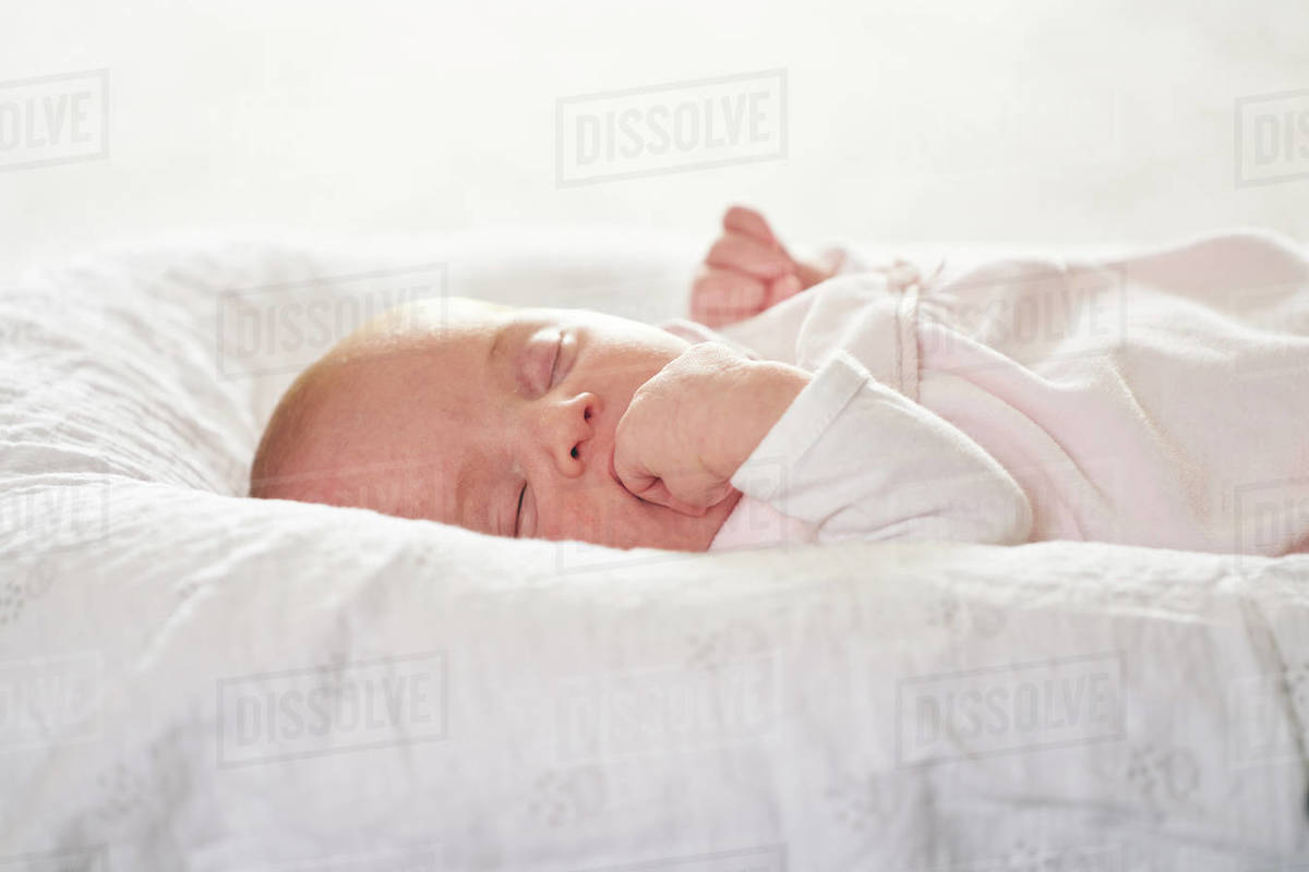 Baby sleeping on U-shaped pillow at home Royalty-free stock photo