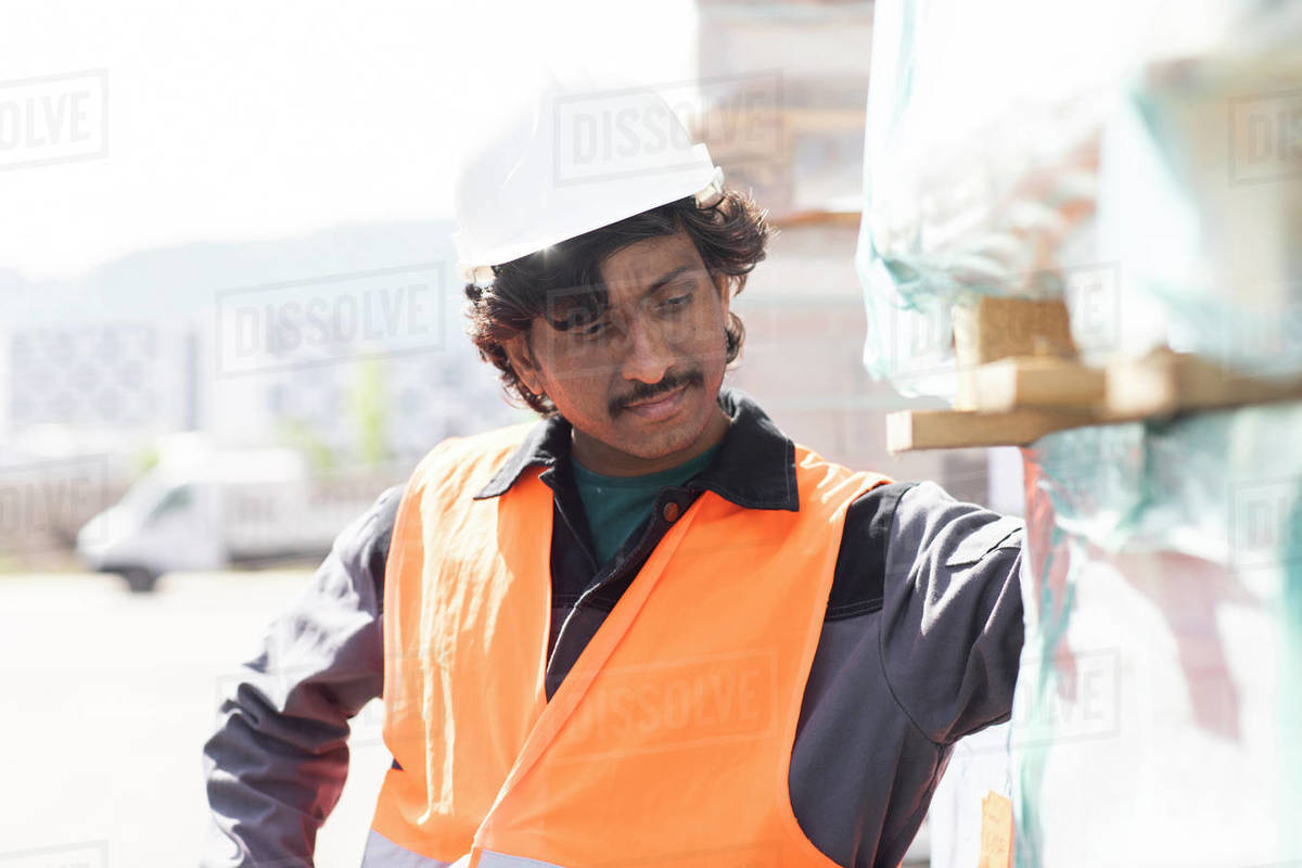 Male engineer on construction site inspecting construction materials Royalty-free stock photo