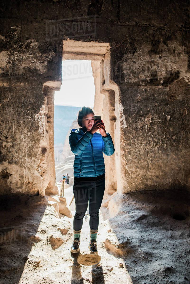 Woman taking photograph in Selime Monastery, Göreme, Cappadocia, Nevsehir, Turkey Royalty-free stock photo
