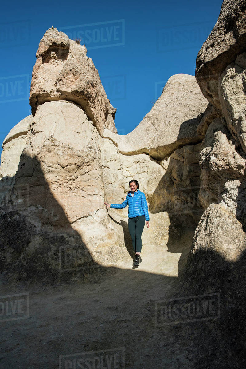 Woman exploring cave, Göreme, Cappadocia, Nevsehir, Turkey Royalty-free stock photo