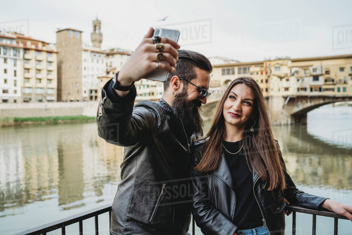 Couple taking selfie on bridge, Ponte Vecchio, Firenze, Toscana, Italy Royalty-free stock photo