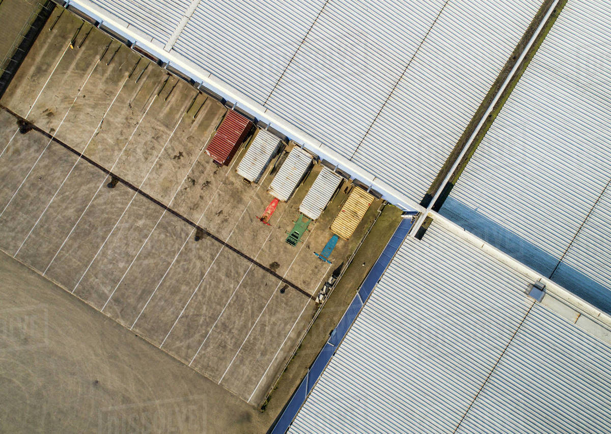 Birds eye view of lorries parked in a loading bay of an industrial unit. Royalty-free stock photo