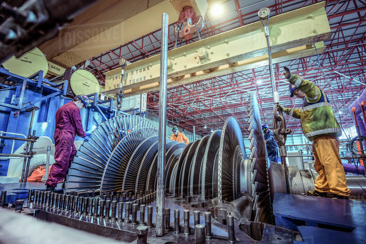 Engineers inspecting a turbine in a  nuclear power station. Royalty-free stock photo