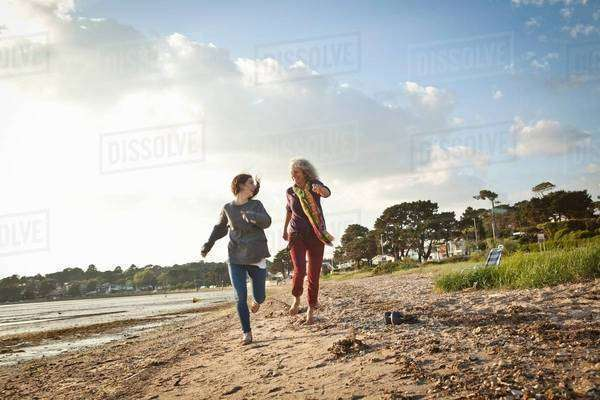 Mother and daughter enjoying beach Royalty-free stock photo