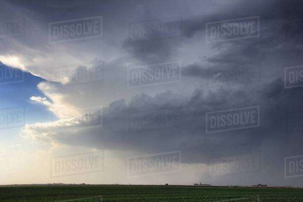 Rapidly rotating wallcloud with striations about the updraft base forms over rural area, Lexington, Nebraska, USA Royalty-free stock photo