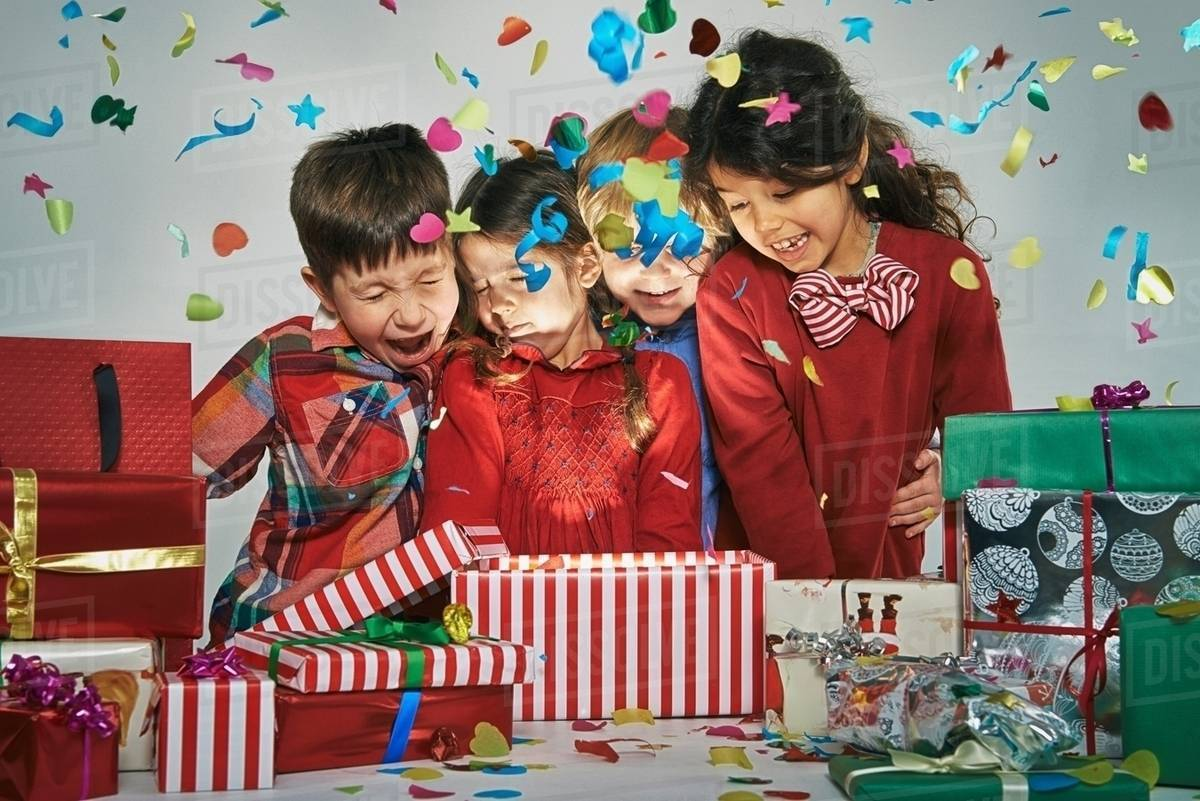 Surprised brothers and sisters unwrapping glowing christmas gift box with exploding confetti  sc 1 st  Dissolve & Surprised brothers and sisters unwrapping glowing christmas gift box ...