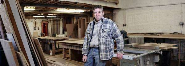 Portrait of a cabinet maker in his workshop Royalty-free stock photo