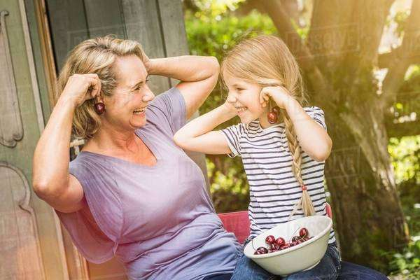 Grandmother and granddaughter together Royalty-free stock photo