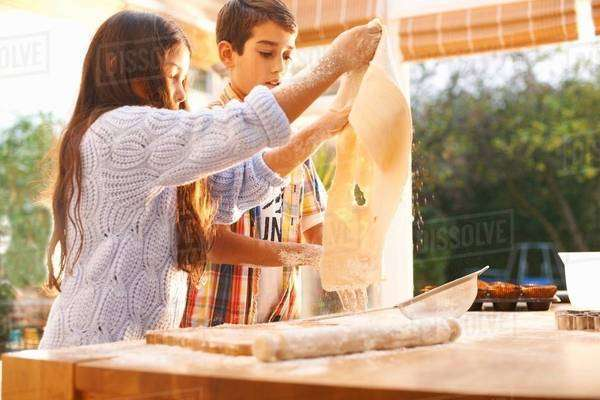 Children making dough in kitchen Royalty-free stock photo