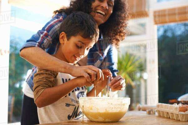 Mother and son baking in kitchen Royalty-free stock photo