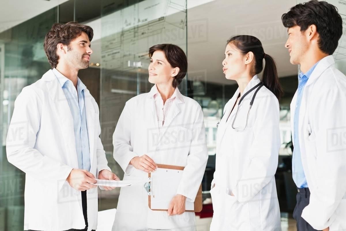 Doctors talking in hallway - Stock Photo - Dissolve