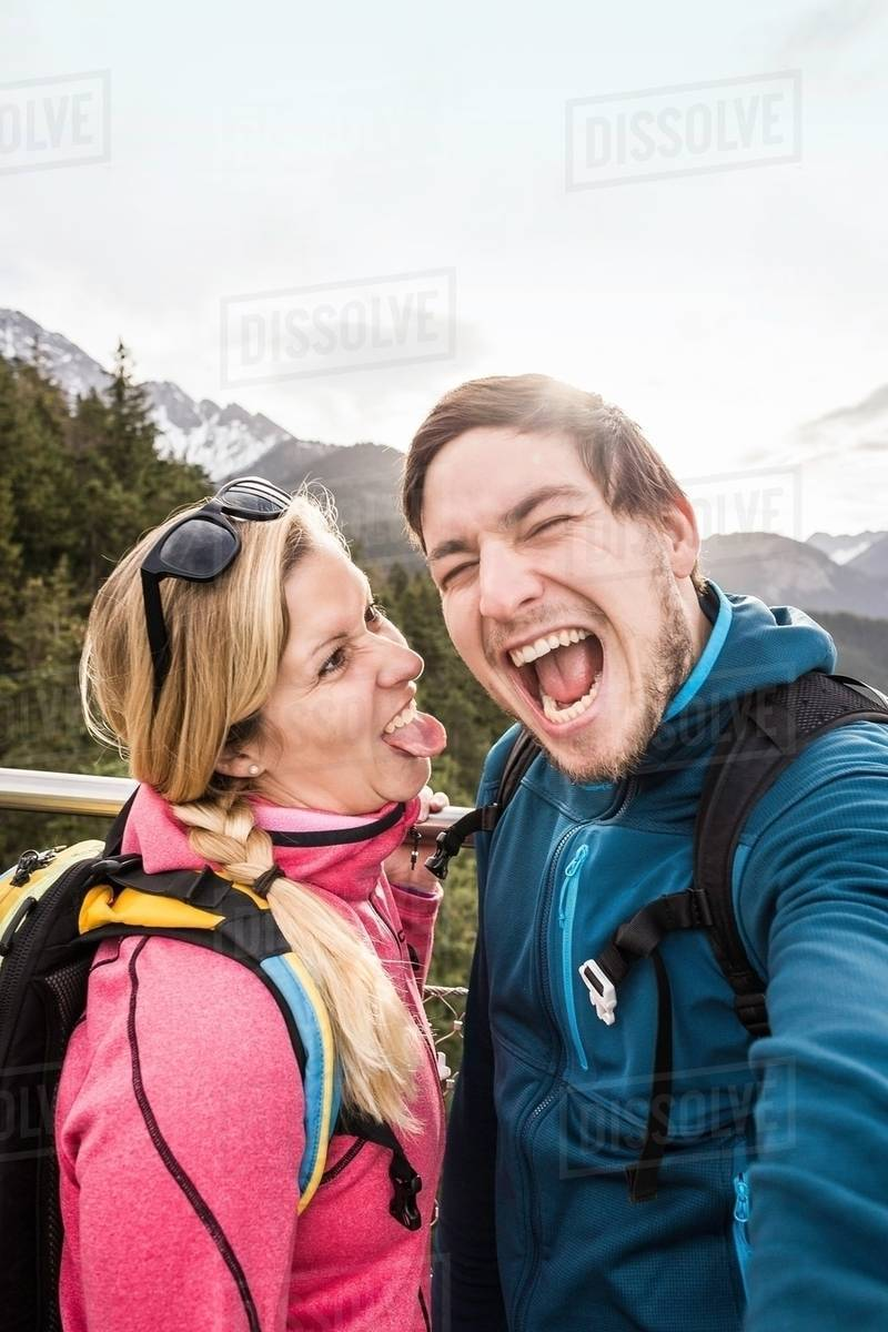 Young Hiking Couple Posing For Selfie In Mountains Reutte Tyrol Austria