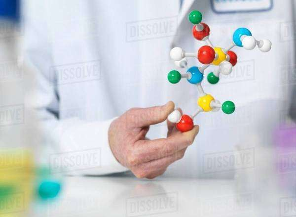 Scientist holding a molecular model of a chemical formula Royalty-free stock photo