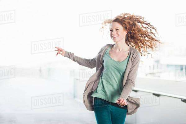 Excited young woman running on rooftop Royalty-free stock photo