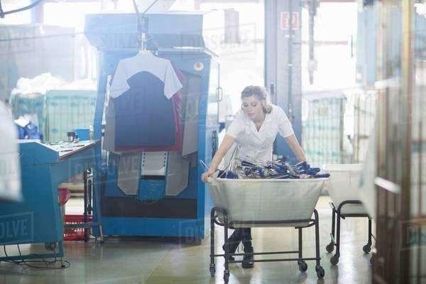 Woman working in laundry Royalty-free stock photo
