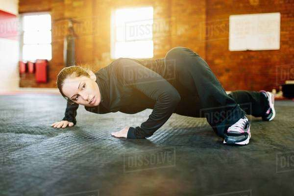 Woman doing stretching exercise in gym Royalty-free stock photo