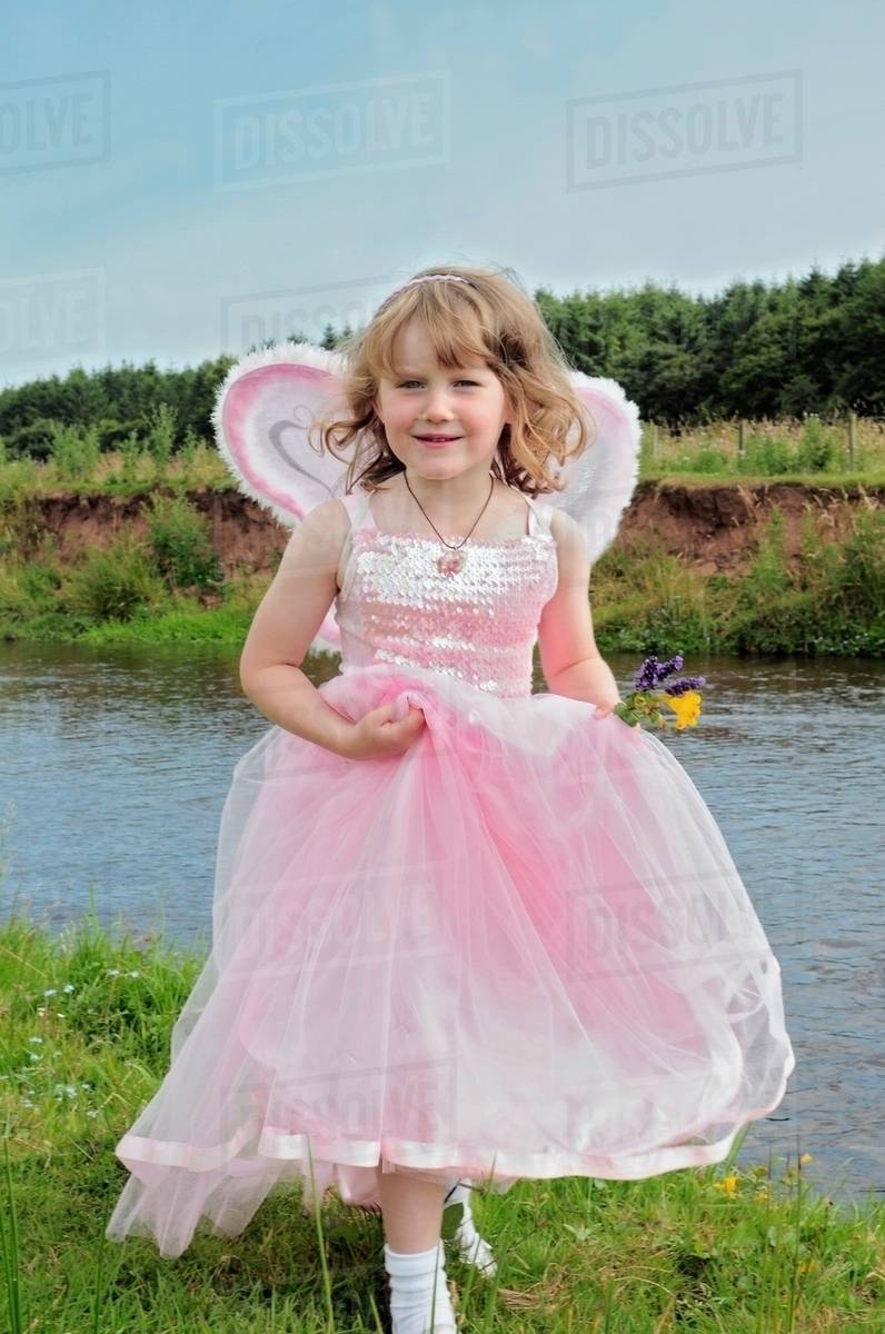 Girl wearing fairy costume by creek Royalty-free stock photo