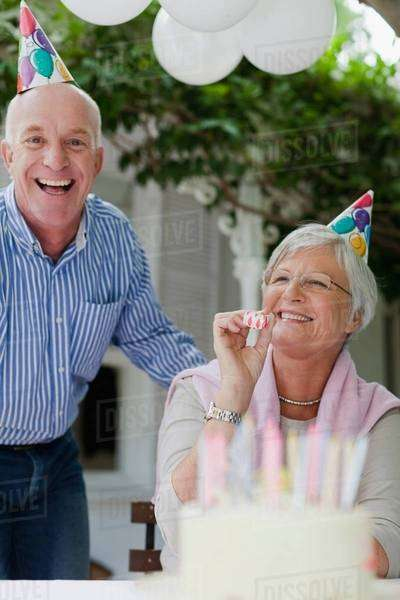 Older couple laughing at birthday party Royalty-free stock photo