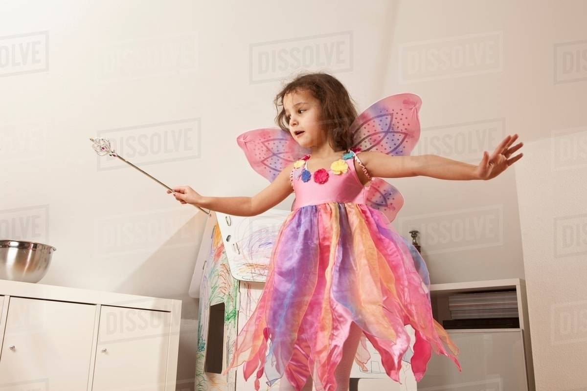 Girl in pink dress with fairy wings Royalty-free stock photo