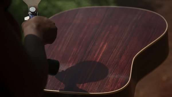 Close-up shot of luthier varnishing a guitar Royalty-free stock video
