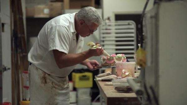Medium shot of a baker decorating a cake Royalty-free stock video