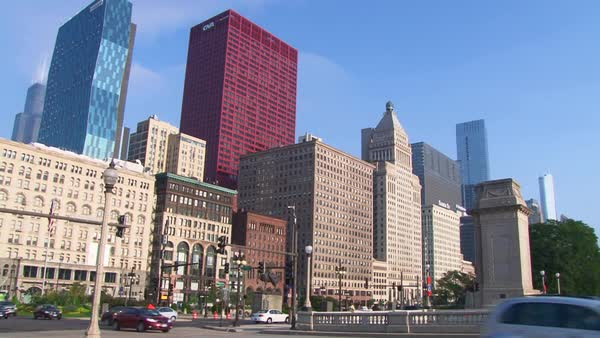 Chicago, Illinois downtown traffic and buildings shot from street, camera pan across Congress Parkway. Royalty-free stock video