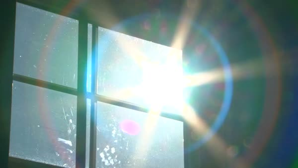 Sun shines bright through window, zoom out with science fiction warp effect. Royalty-free stock video