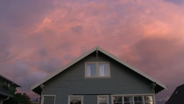 House Sunset in series 2 of 4. Full sunset over house with lights turning on and off as night falls. Royalty-free stock video