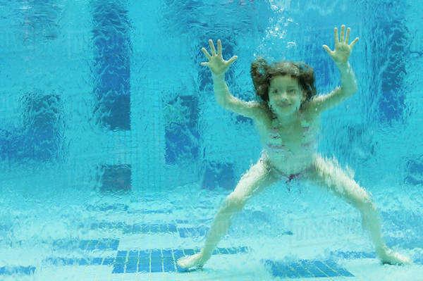 Girl Swimming Underwater In Swimming Pool - Stock Photo - Dissolve-4785