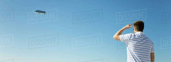 Man looking at blimp in sky Royalty-free stock photo