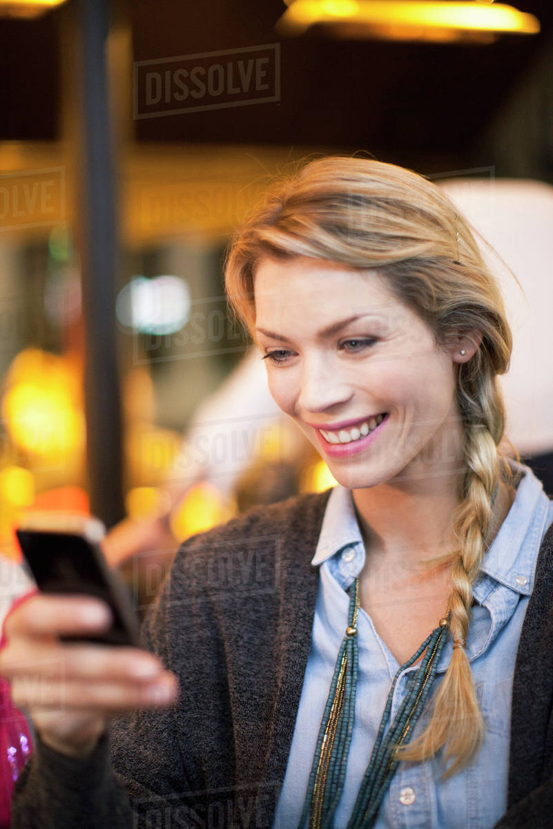 Woman with smartphone taking photograph Royalty-free stock photo