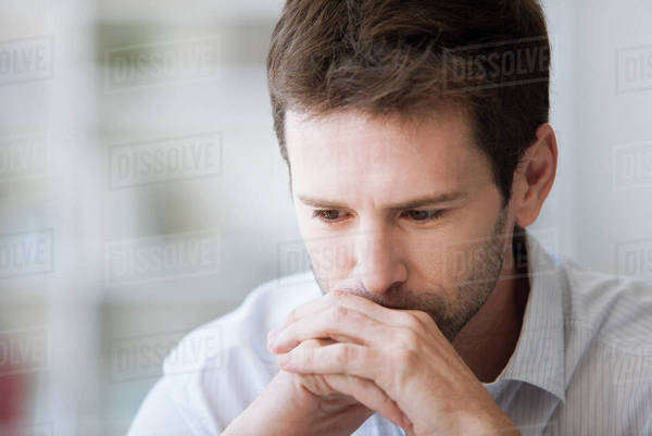 Mid-adult man in thought, portrait Royalty-free stock photo