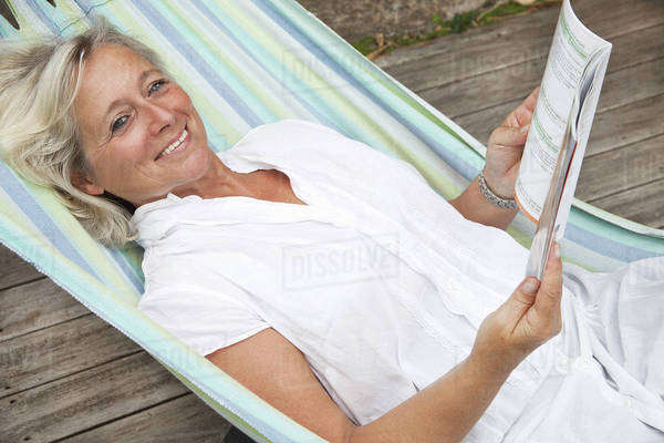 Mature woman relaxing in hammock, portrait Royalty-free stock photo