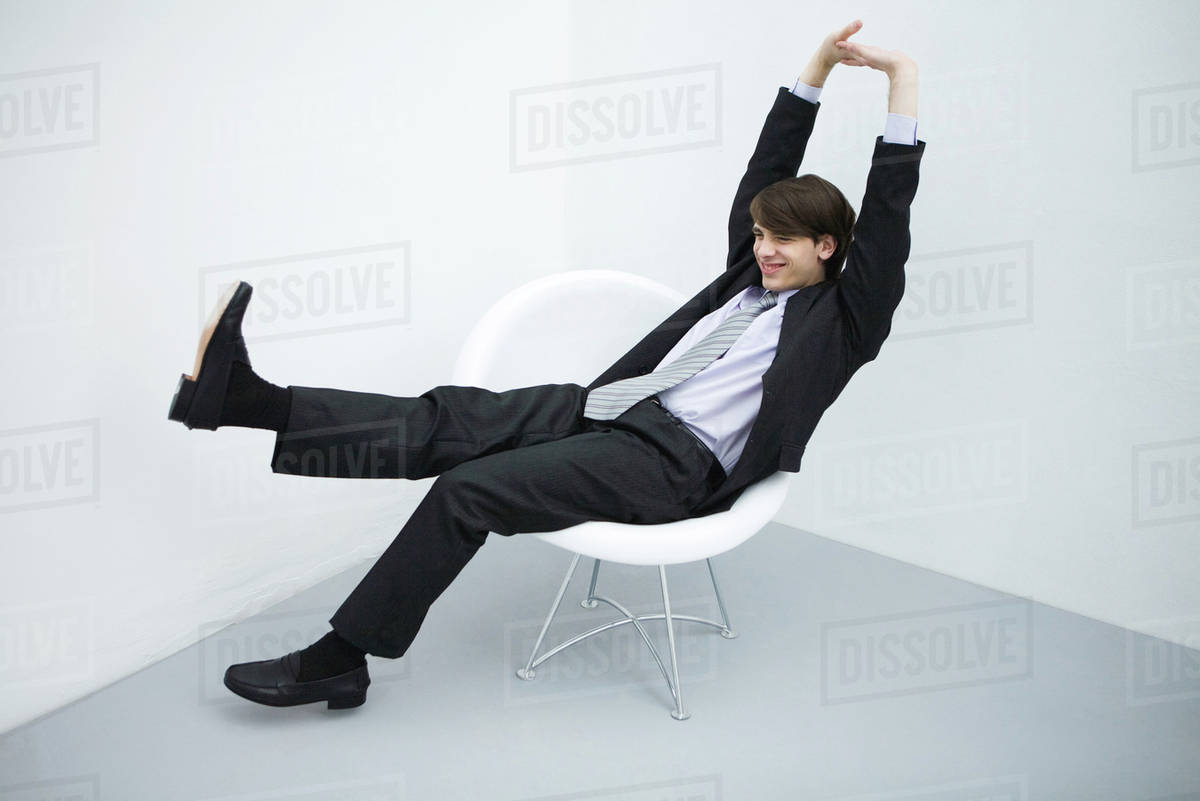 Young Man In Suit Sitting In Chair Legs Outstretched Arms D984 26 891