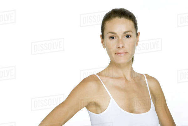Woman in tank top looking at camera, portrait Royalty-free stock photo