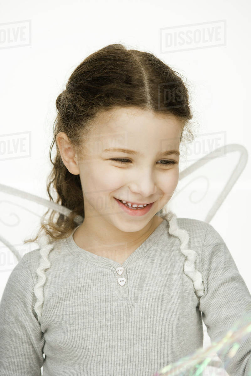 Little girl wearing wings, smiling, portrait Royalty-free stock photo