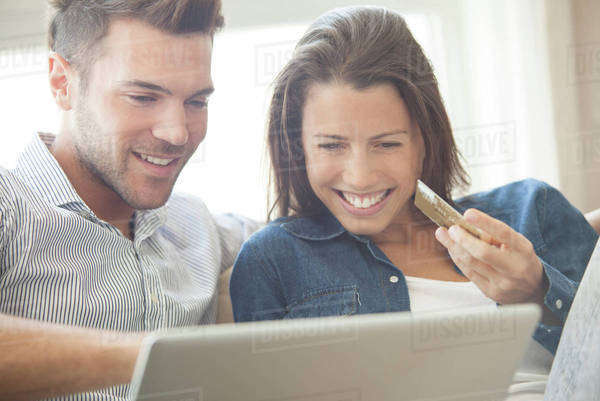 Couple at home shopping online together Royalty-free stock photo
