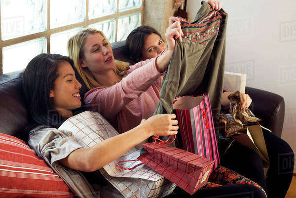 Young women looking at contents of shopping bags together Royalty-free stock photo
