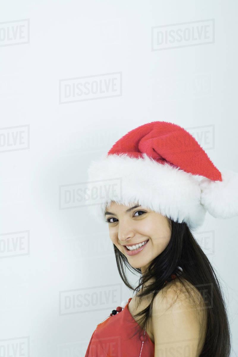 d6643ac63e166 Young woman wearing santa hat
