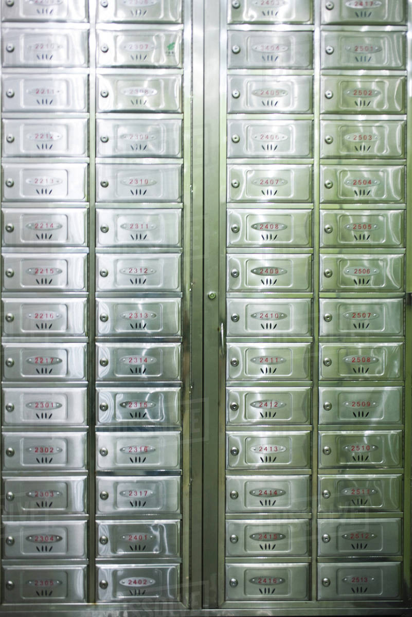 Apartment building mailboxes stock photo