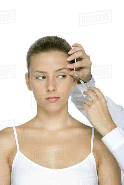 Young woman receiving Botox injection Royalty-free stock photo