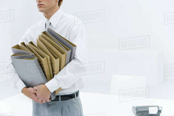 Office worker carrying many binders, cropped view Royalty-free stock photo