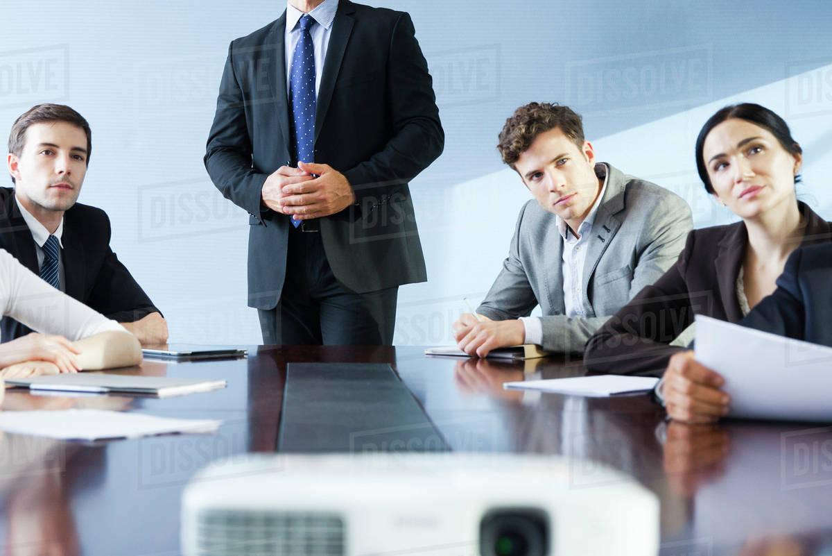 executive making presentation at business meeting stock photo