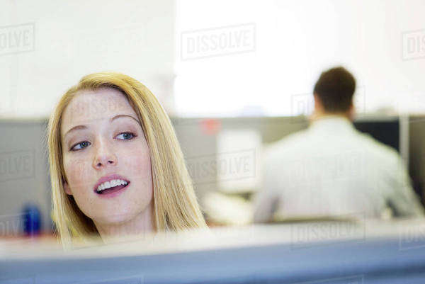 Office worker peering over cubicle wall Royalty-free stock photo