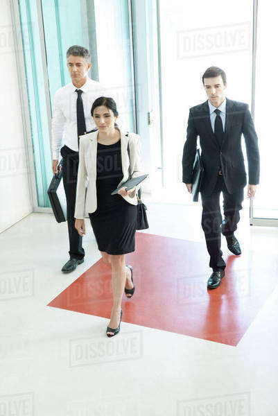 Business professionals entering office building lobby Royalty-free stock photo