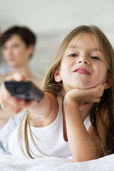 Little girl holding remote control Royalty-free stock photo