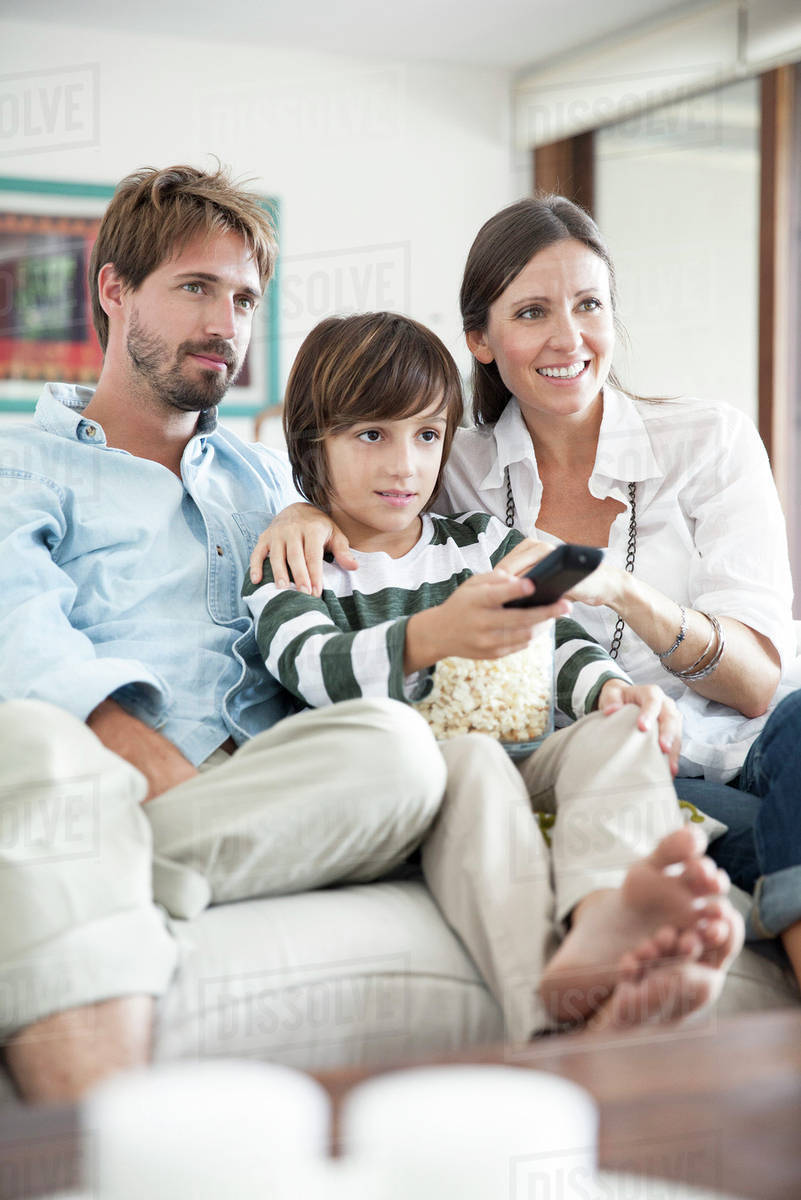 family watching tv together stock photo dissolve
