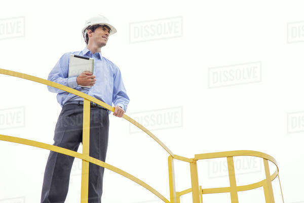 Engineer inspecting industrial site, low angle view Royalty-free stock photo