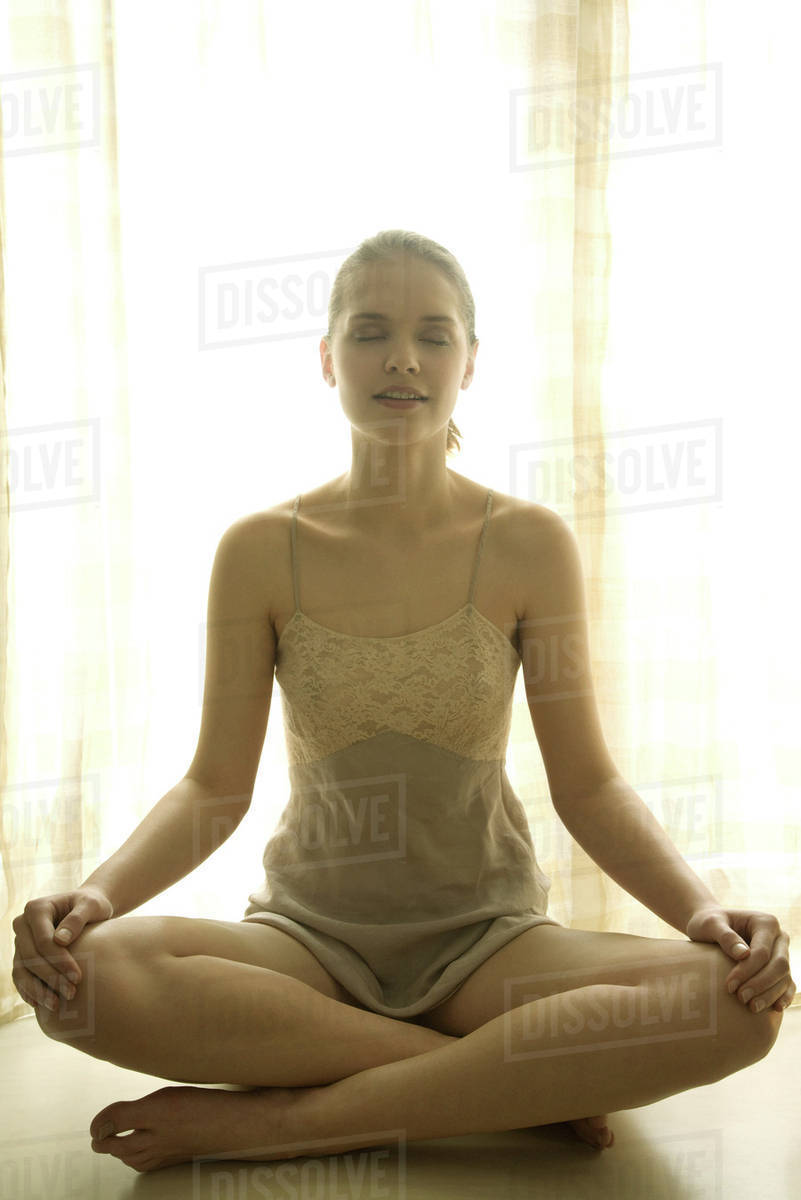 Teen Girl Wearing Slip, Sitting Indian Style With Eyes Closed - Stock Photo - Dissolve-9341
